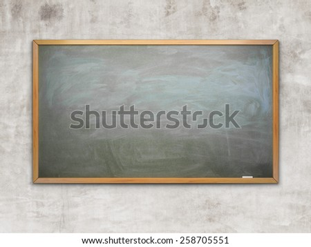 Black chalk board with wooden frame on wall - stock photo