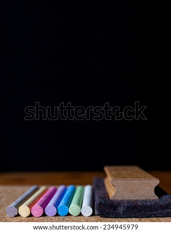 black chalkboard with chalk colors - stock photo