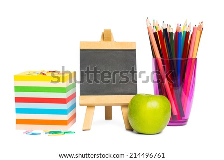 Black chalkboard with school supplies on white background