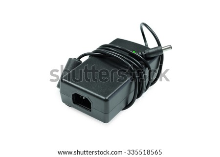 Black charger isolated. Power charger. Electric charger. Adapter isolated. Electric cable. Battery charger. Recharge battery. Electronic charge object. Jack charger isolated. Clipping path recharger - stock photo