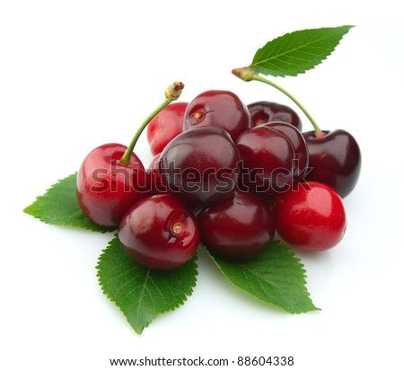 Black cherries with leafs on white - stock photo