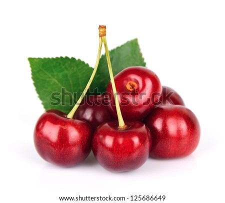 Black cherries with leafs on white. Healthy food - stock photo