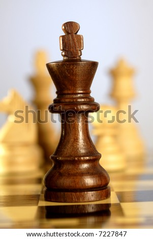 Black chess king,A game of chess comes to an end. The king is checkmated. - stock photo