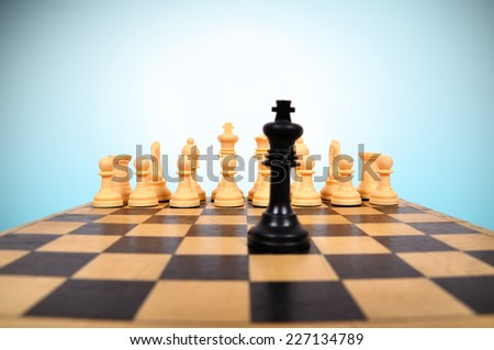 Black Chess King and chess pieces - stock photo
