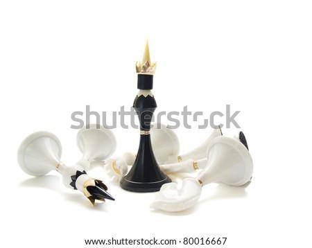 Black chess king beats whites isolated over white background - stock photo