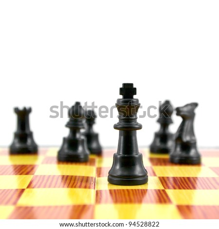 Black chess king, the leader of army isolated on white background