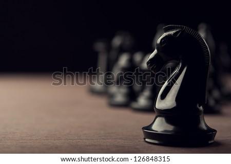 black chess knight on background - stock photo
