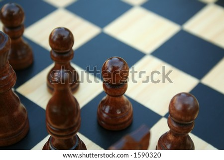 black chess on wooden chessboard - stock photo