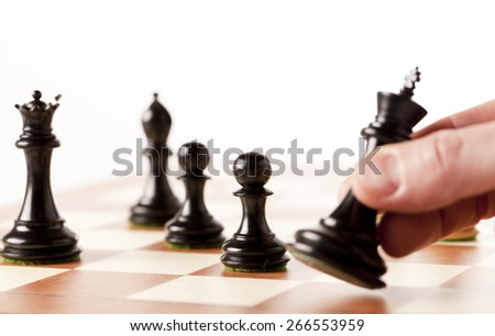 black chess pieces on a chess board, winning concept - stock photo