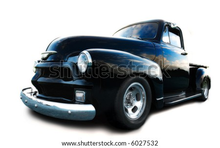black chevy truck, with blue sky reflected in bodywork - stock photo