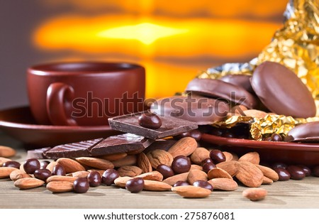 black chocolate and nuts on wooden table - stock photo