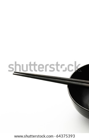 Black chopsticks and black bowl  isolated on white background - stock photo