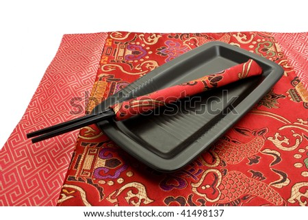 black chopsticks and plate