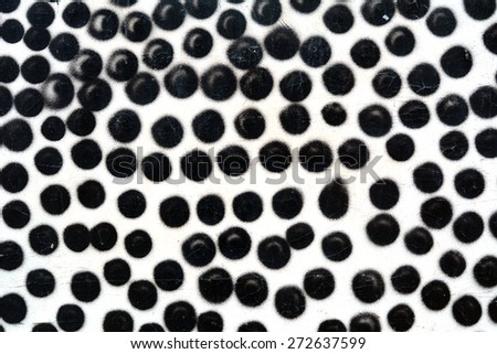 Black circles, drawn with paint on the wall - stock photo