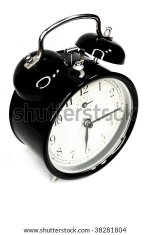 Black classic alarm clock isolated on white background.