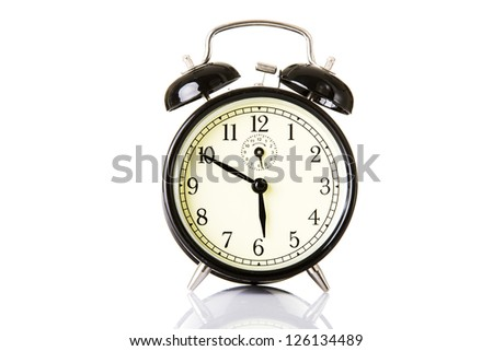 Black classic style alarm clock isolated on white
