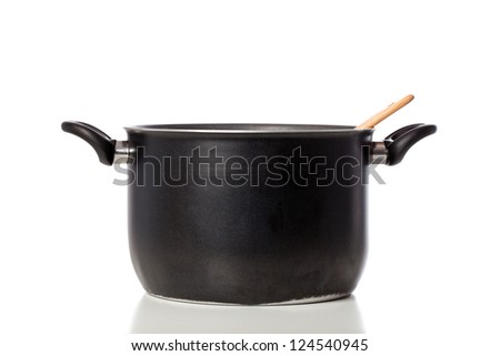 Black clay pot with wooden ladle on white background - stock photo