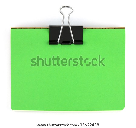 Black clip and green blank note paper - stock photo