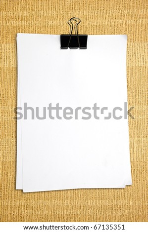 Black clip and White blank note paper on wallpaper - stock photo