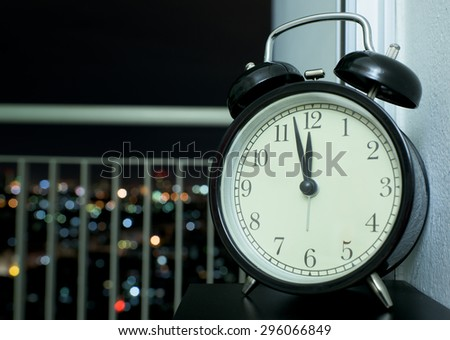 Black Clock with City Light Background,Bangkok,Thailand