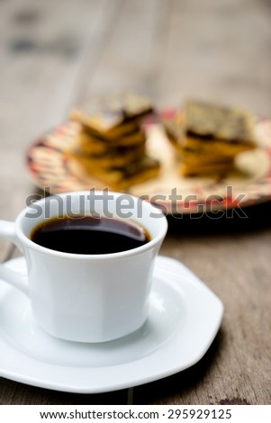 black coffee and Homemade chocolate peanut butter in wooden table - stock photo