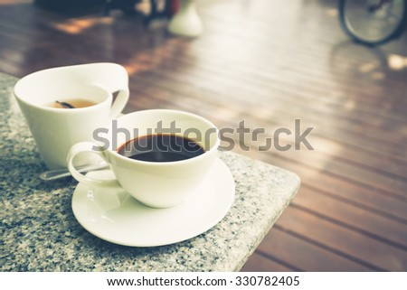 Black coffee and tea outdoor on wood terrace
