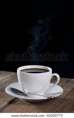 black coffee and textured wood against black background - stock photo