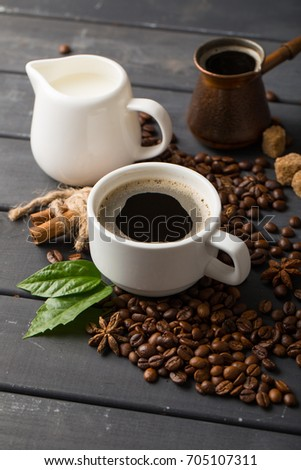 black coffee beans on black background