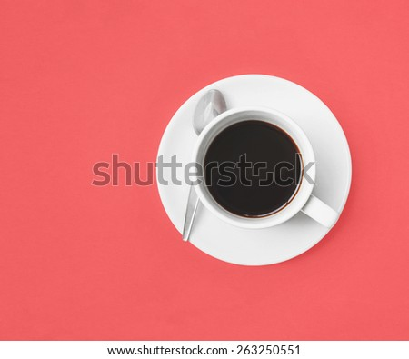 black coffee cup on pink background (retro style) - stock photo