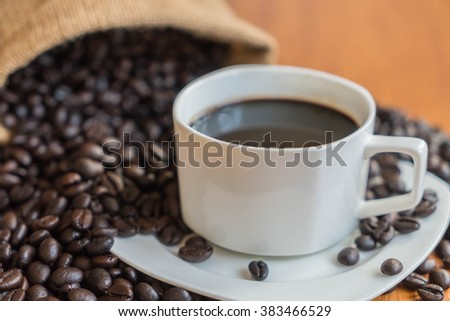 black coffee cup on wood background