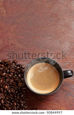 black coffee cup over grunge wooden table - stock photo