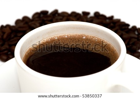 Black coffee in mug and coffee beans