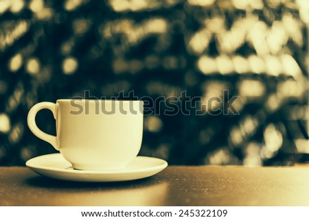 Black coffee in white cup on wooden table in coffee shop cafe - Vintage effect style pictures