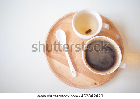 Black coffee in white cup on wooden tray. - stock photo