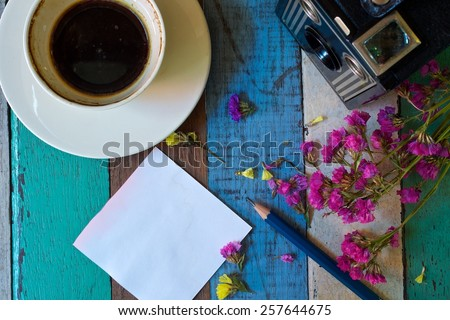 Black coffee note on wood background vintage tone still life  - stock photo