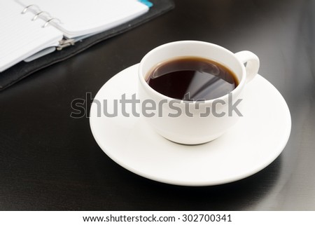 Black coffee on black table