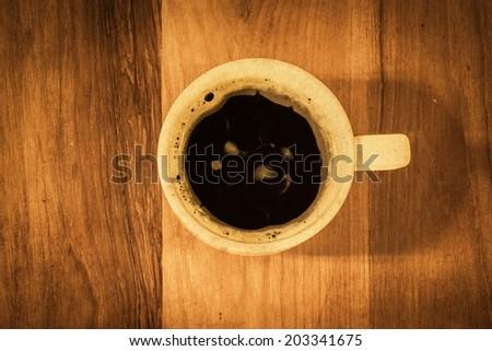 Black coffee on grunge table. retro filter - stock photo