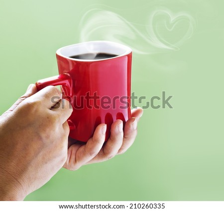 Black coffee on red cup from mother  - stock photo