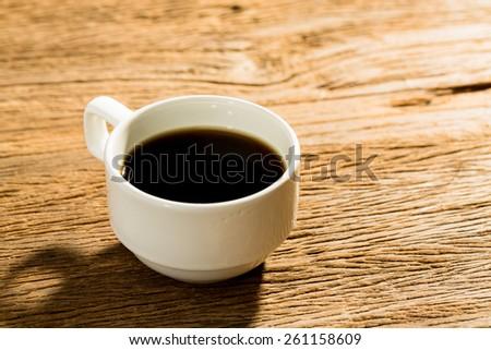 black coffee on wood table. - stock photo