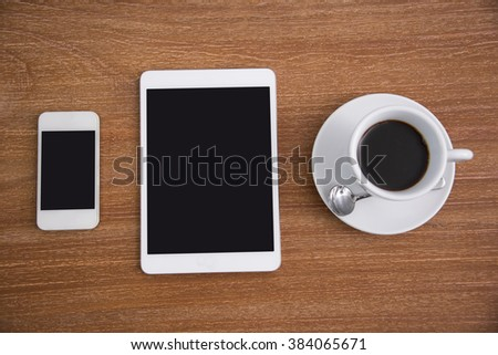 Black coffee with blank digital tablet and mobile phone on desk. - stock photo