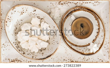 Black coffee with meringue cookies. Retro style porcelain tableware. Top view - stock photo