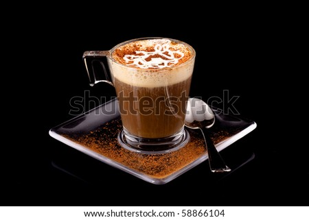 black coffee with whipped cream and cinnamon in a glass mug