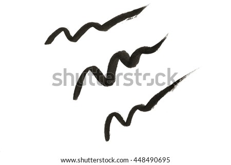 Black color Eye liner strokes on background - stock photo