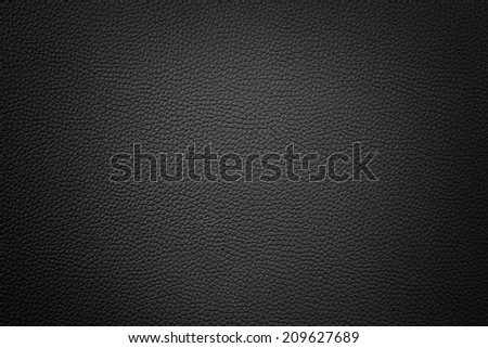black color synthetic leather texture background with vignette - stock photo