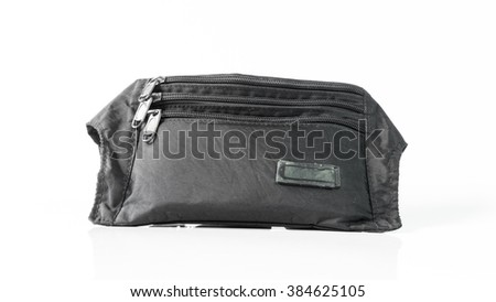 Black color zippered canvas pouch. Isolated on white background. Slightly de-focused and close-up shot. Copy space.