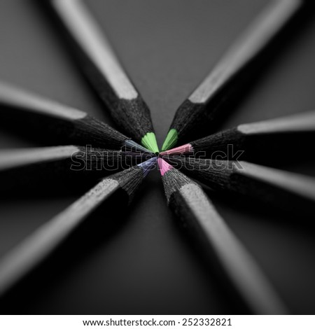 black, colored pencils on black background, Shallow depth of field, pastel colors - stock photo