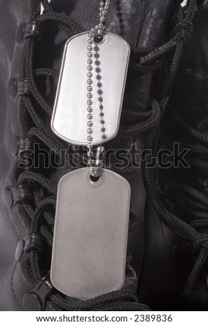 Black combat boots and dog tags