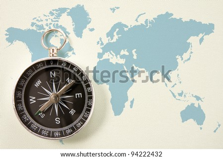 black compass on blue world map. concept for travel and tourism