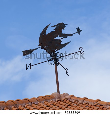 Black Compass wind on red roof - stock photo
