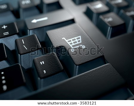 black computer keyboard with a shopping cart symbol on the return key - stock photo